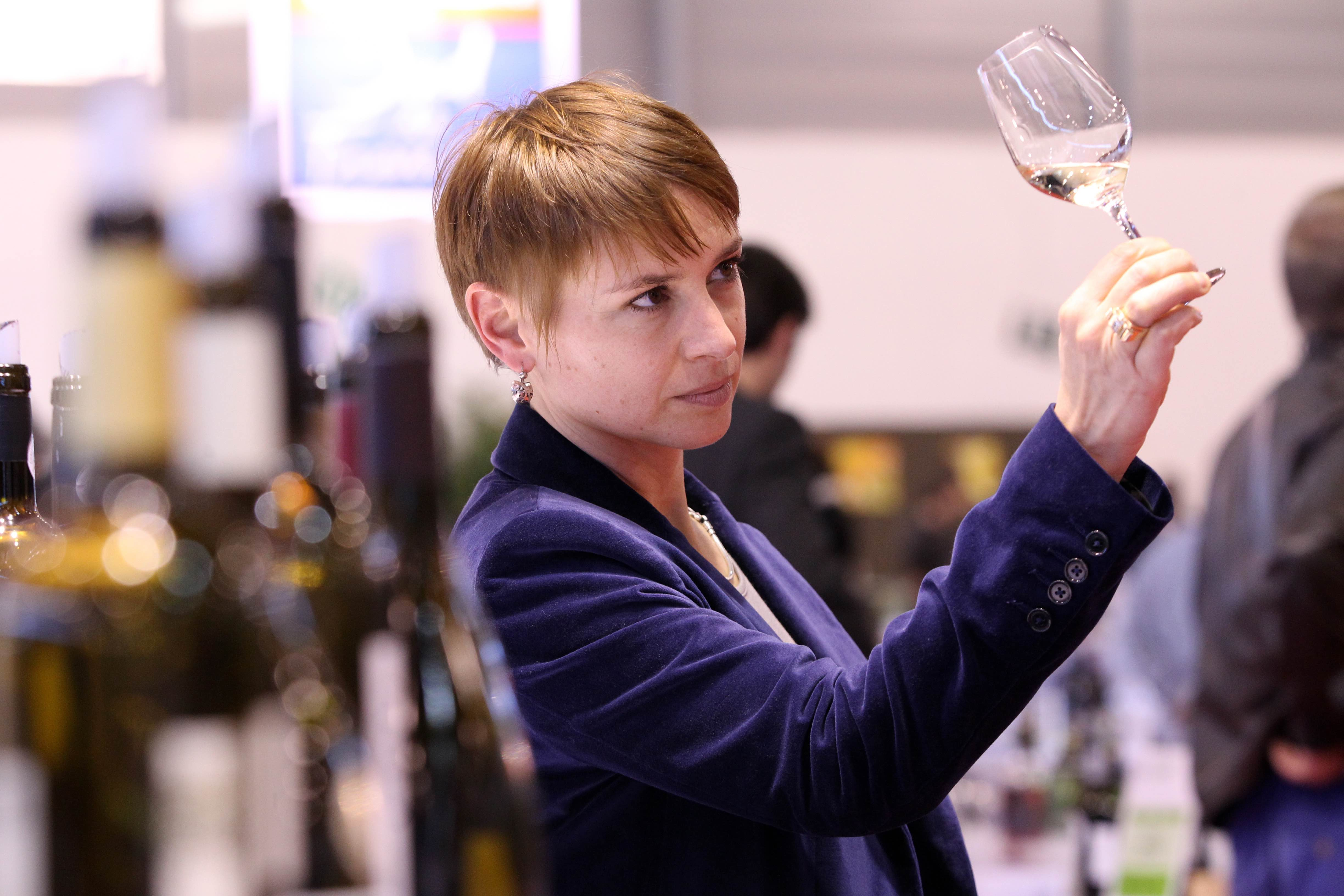 "FRANCE, Montpellier : Visitors taste organic wines on January 27, 2014 at the ""Millesime Bio 2014"" (Vintage Bio 2014) fair in the south western city of Montpellier. Millesime Bio, which goal is to promote products (wines made from organically grown grapes) and to feature new vintages for the buyers, welcomed last year 700 exhibitors and 15 countries were represented."