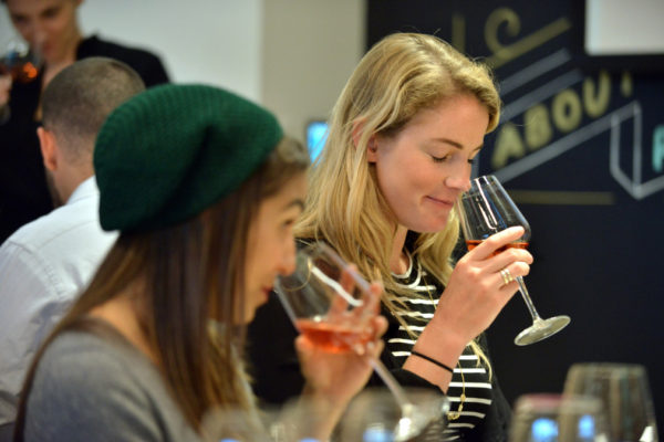 BOSTON, MA - MAY 8: from left, Elissa Garza, 25, of Boston, and Gabi Parsons, 24, of San Francisco, sample glasses of rose and white during a class that paired finance education with a wine tasting at the Society of Grownups, a financial education company, that uses a coffee shop and dinner club atmosphere to help attract  Millennials. (Photo by Josh Reynolds for The Washington Post via Getty Images)
