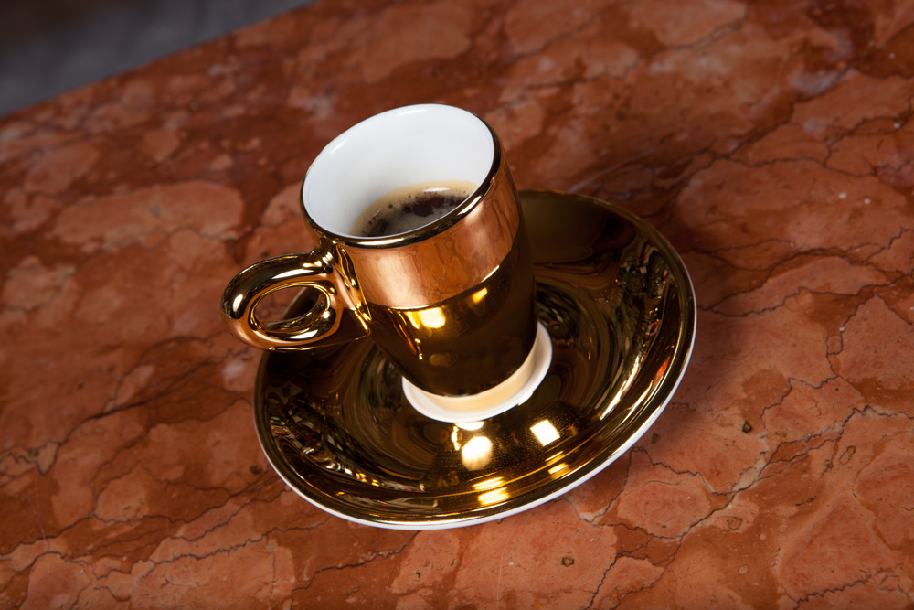 Amir Ghel's specially produced gold coffee cup to be used at Harry's Bar