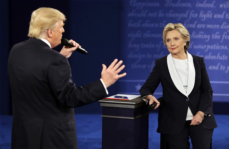 Whatever happens in the US election, the dollar could pay the consequences (AP Photo/John Locher)