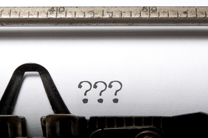 Three question marks printed on a typewriter