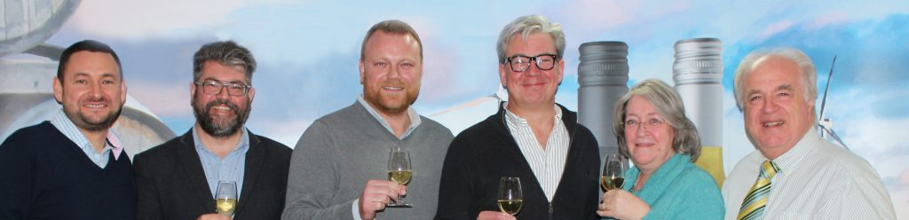 Tony and Veronica Cleary, far right, celebrate taking a strategic stake in Wine Fusion with its MD Christopher Smith, third right, and director, Andrew Porton, along with Lanchester's Barney Davis, far left, and Mark Roberts, third left.