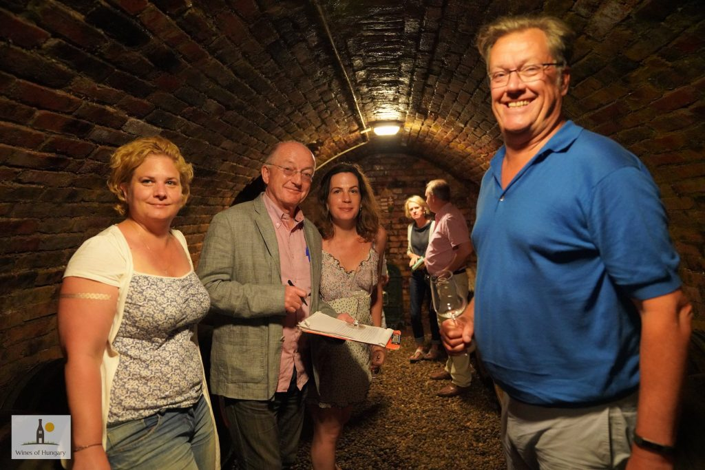 Peter McCombie MW, right, down some Tokaj cellars with Oz Clarke and head of Wines of Hungary UK Lilla O'Connor, centre