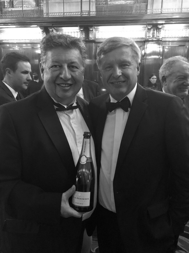 The Harrow's Roger Jones, and ambassador for CSWWC, celebrating with Louis Roederer