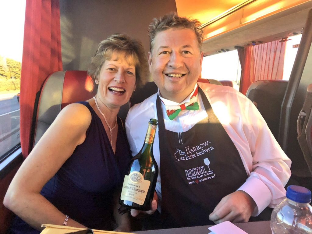 "Roger and Sue Jones on the ""Harrow"" bus with the rest of the team on their way to pick up their AA Wine Award for England at the ceremony last month"