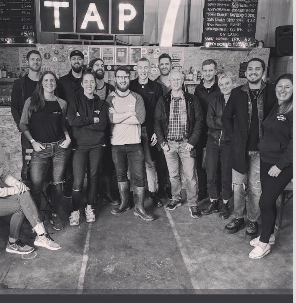 Wolf Alice with the team at the Seven Bro7hers Brewery in Manchester