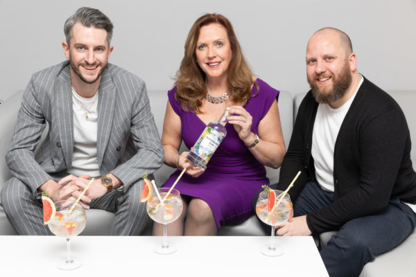 Didsbury Gin founders Liam Manton and Mark Smallwood celebrating their partnership with 'Dragon'  Jenny Campbell who has invested £75,000 into the business in return for a 15% share of the business