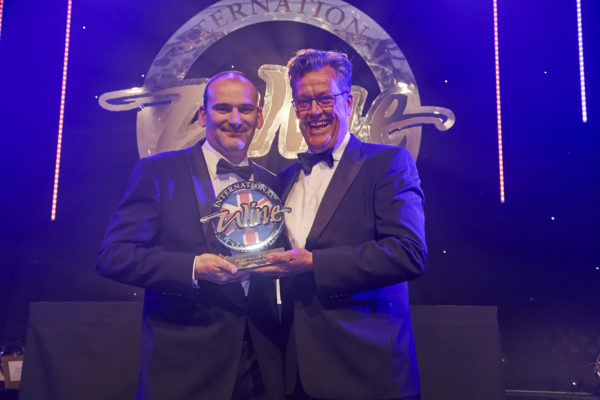 Daniel Lambert receives his IWC Small Agent of the Year award from Peter McCombie MW